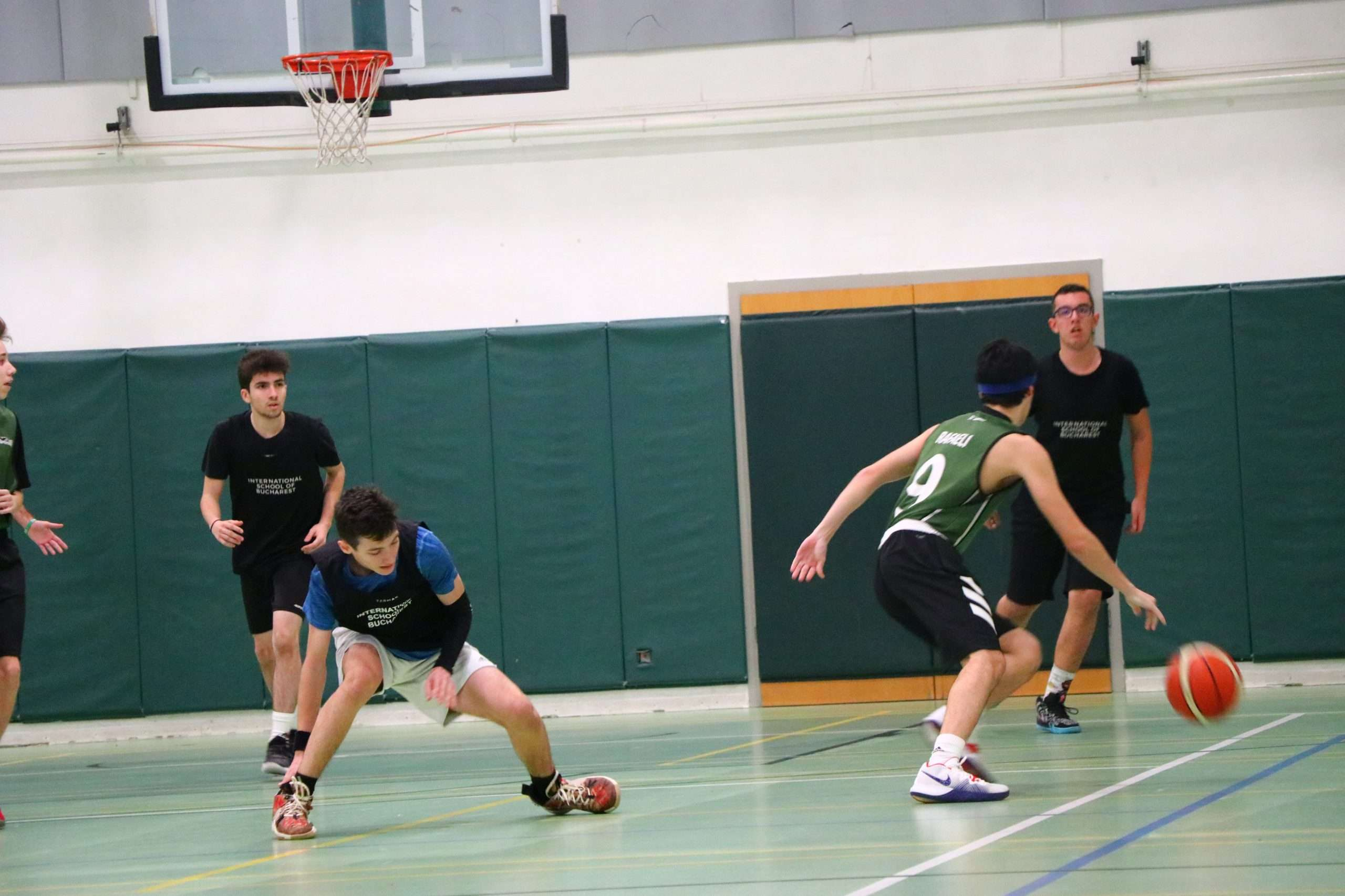 Yoav R. dribbling past the ISB defense